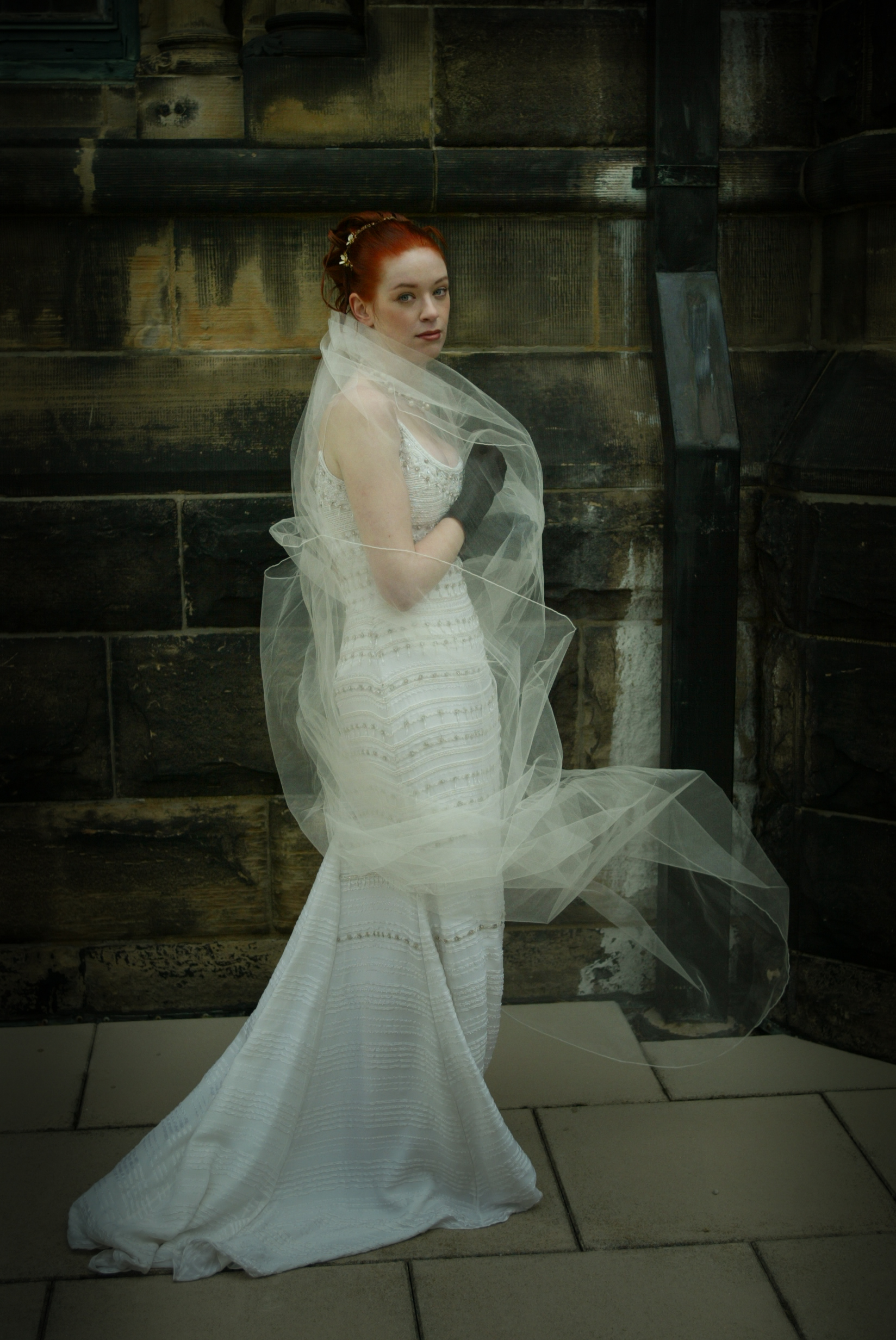 bride with read hair and flowing veil