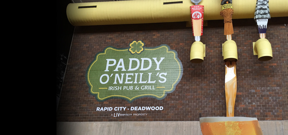 Paddy O'Neill's wrap 3D taps and beer glass