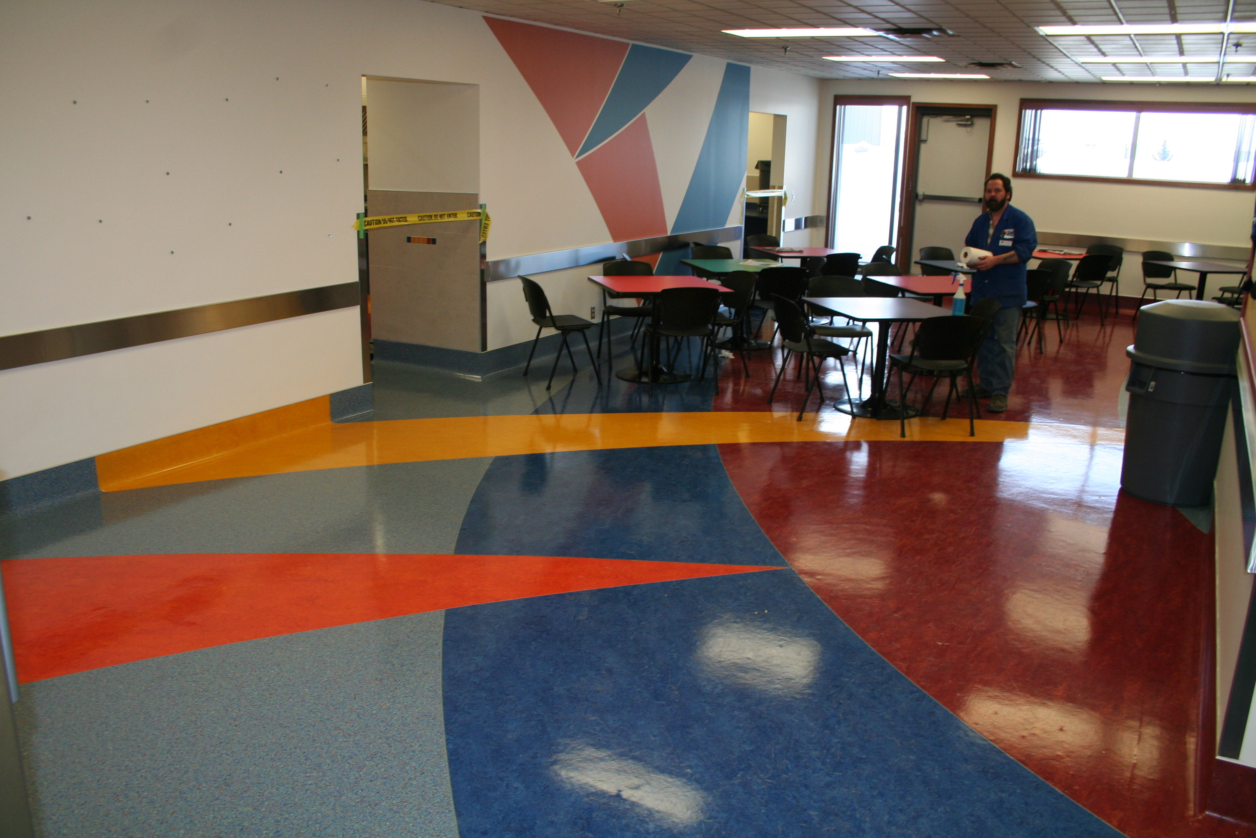 The final result with high gloss wax. Notice the colors on the floor continue onto the coving and the paint above