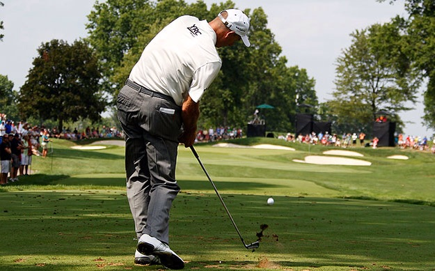 Jim Furyk staying in posture with his right arm trapped to his side