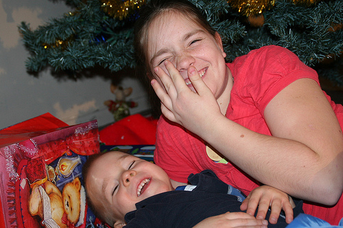 family-on-the-edge-photo-of-daughter-and-son-at-christmas-three.jpg