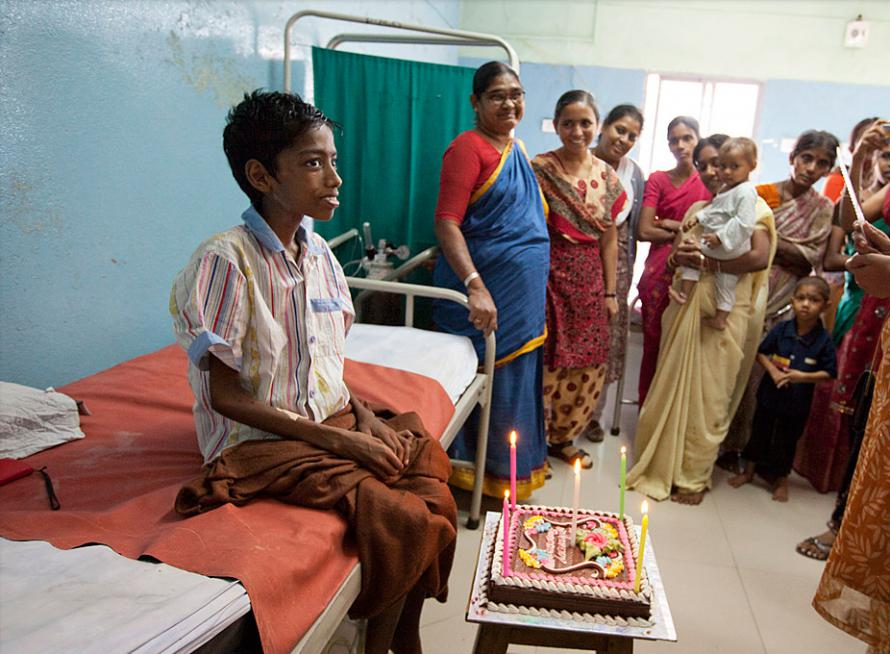 Suresh's surrogate family—fellow patients and their parents, staff and volunteers gather to celebrate his 13th Birthday in the paediatric ward.
