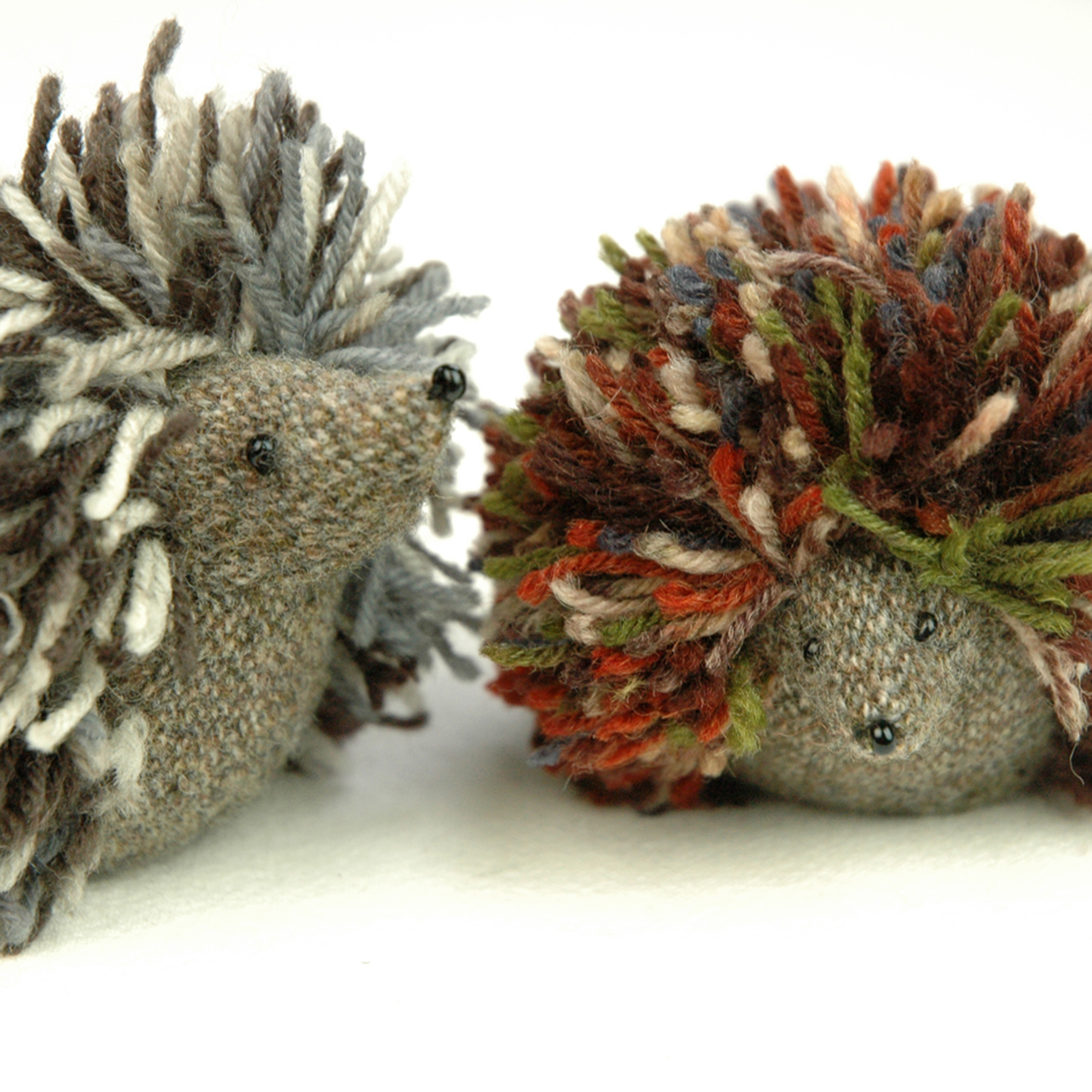 Handmade hedgehog paperweights.