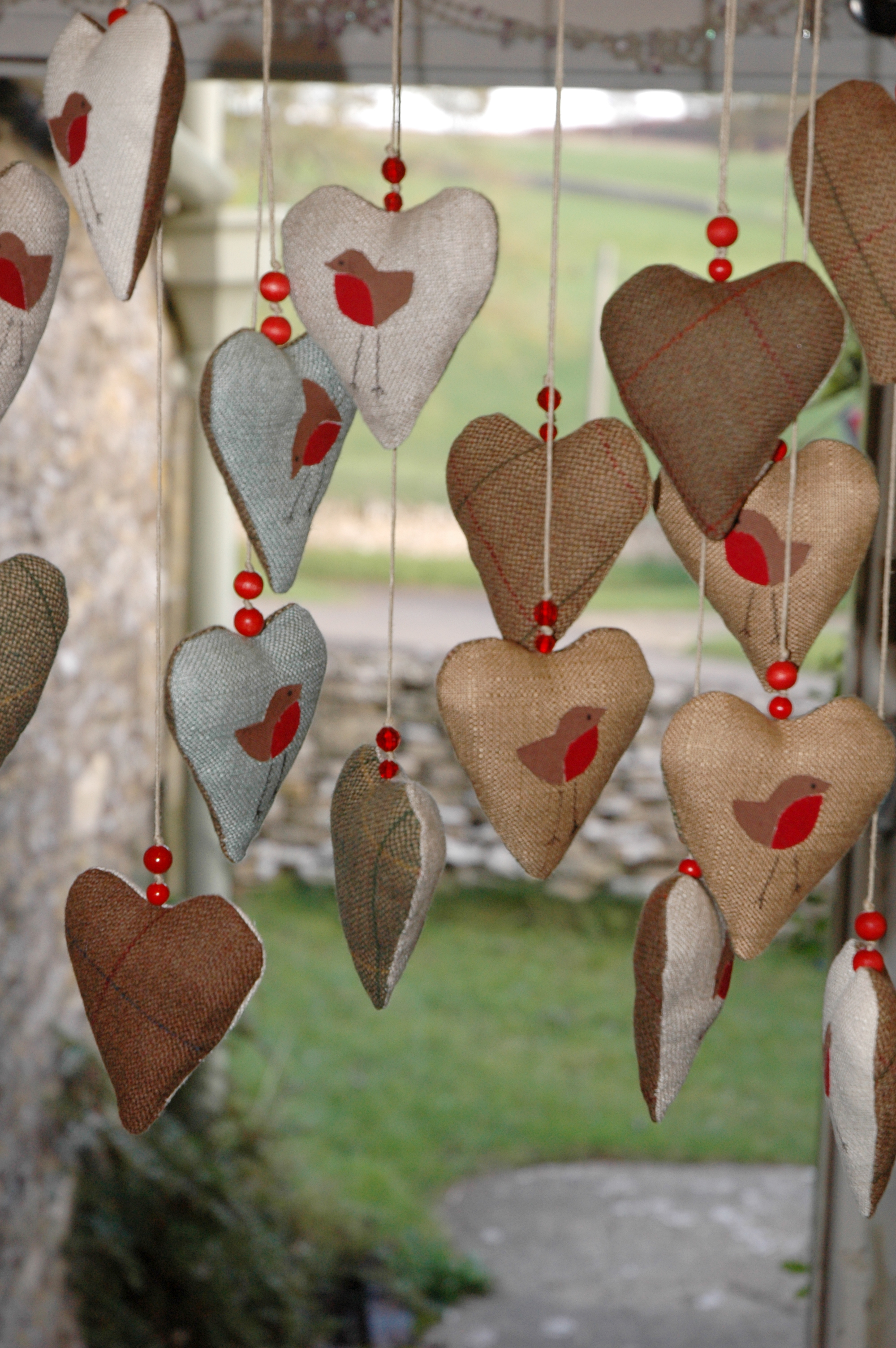 Handmade hanging hearts in the first studio of Laura Mirjami's.