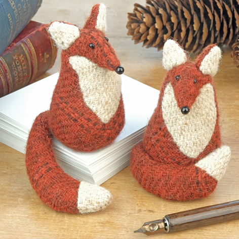 Handmade tweed fox paperweights.