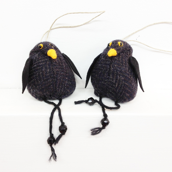 Handmade tweed blackbird hanging decorations.
