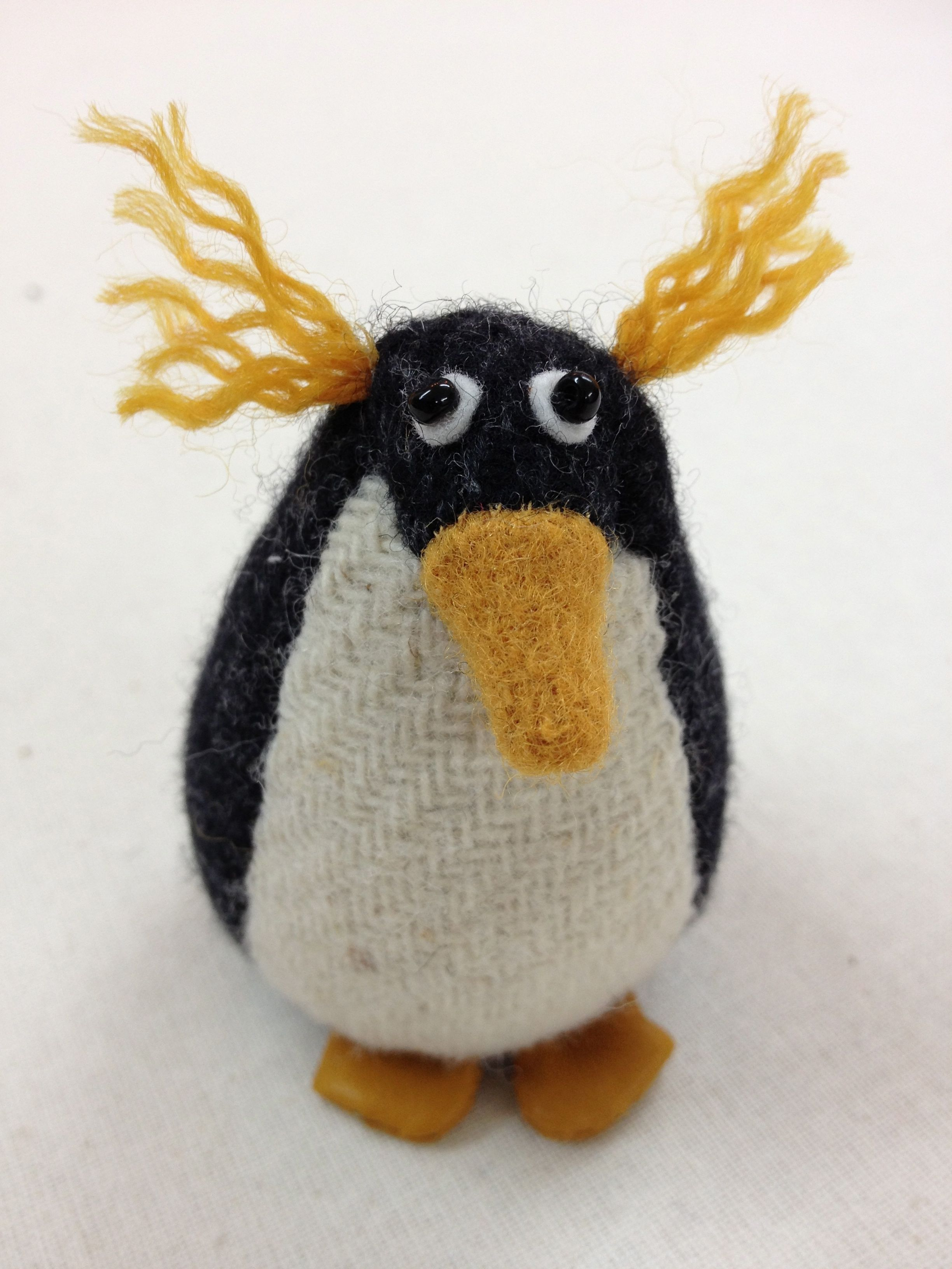 Handmade Pedro the Penguin tweed paperweight.