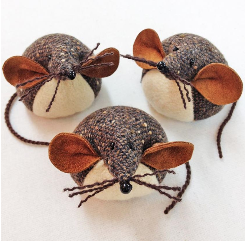 Trio of handmade tweed mice paperweights.