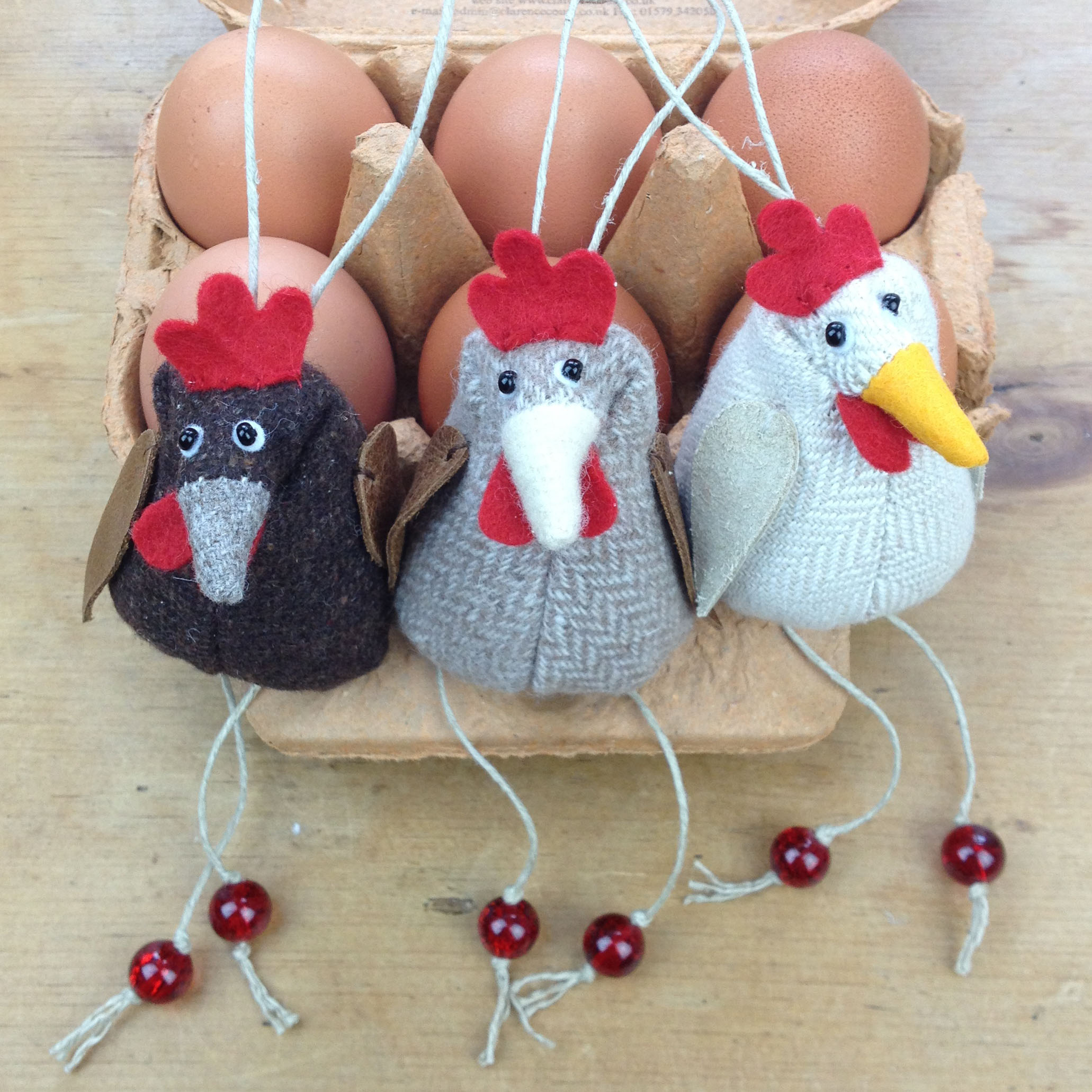Handmade trio of tweed hanging chickens with leather wings.
