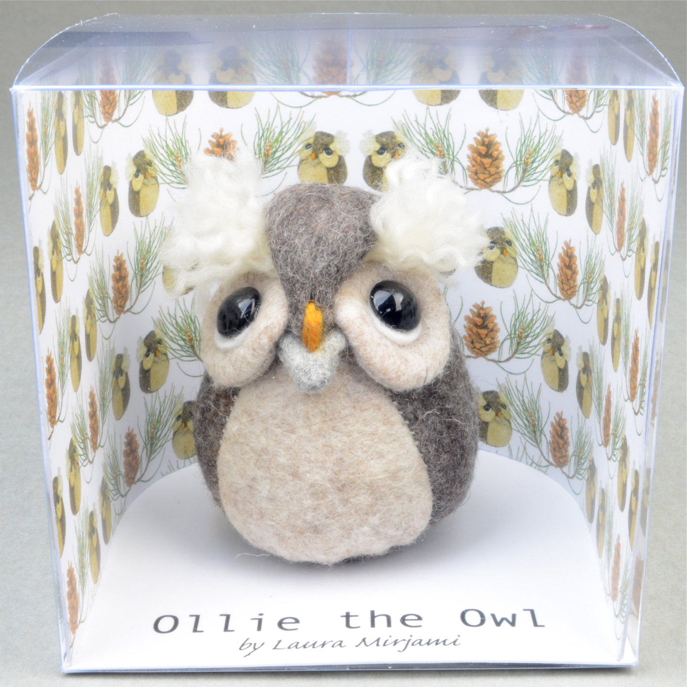Handmade Ollie the Owl felt paperweight in a new packaging.