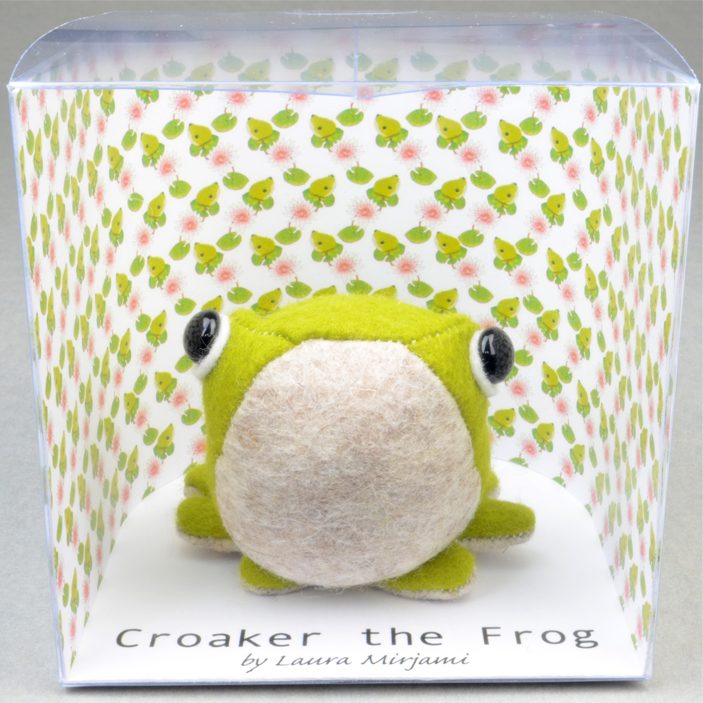 Handmade felt Croaker the Frog paperweight in a new packaging.