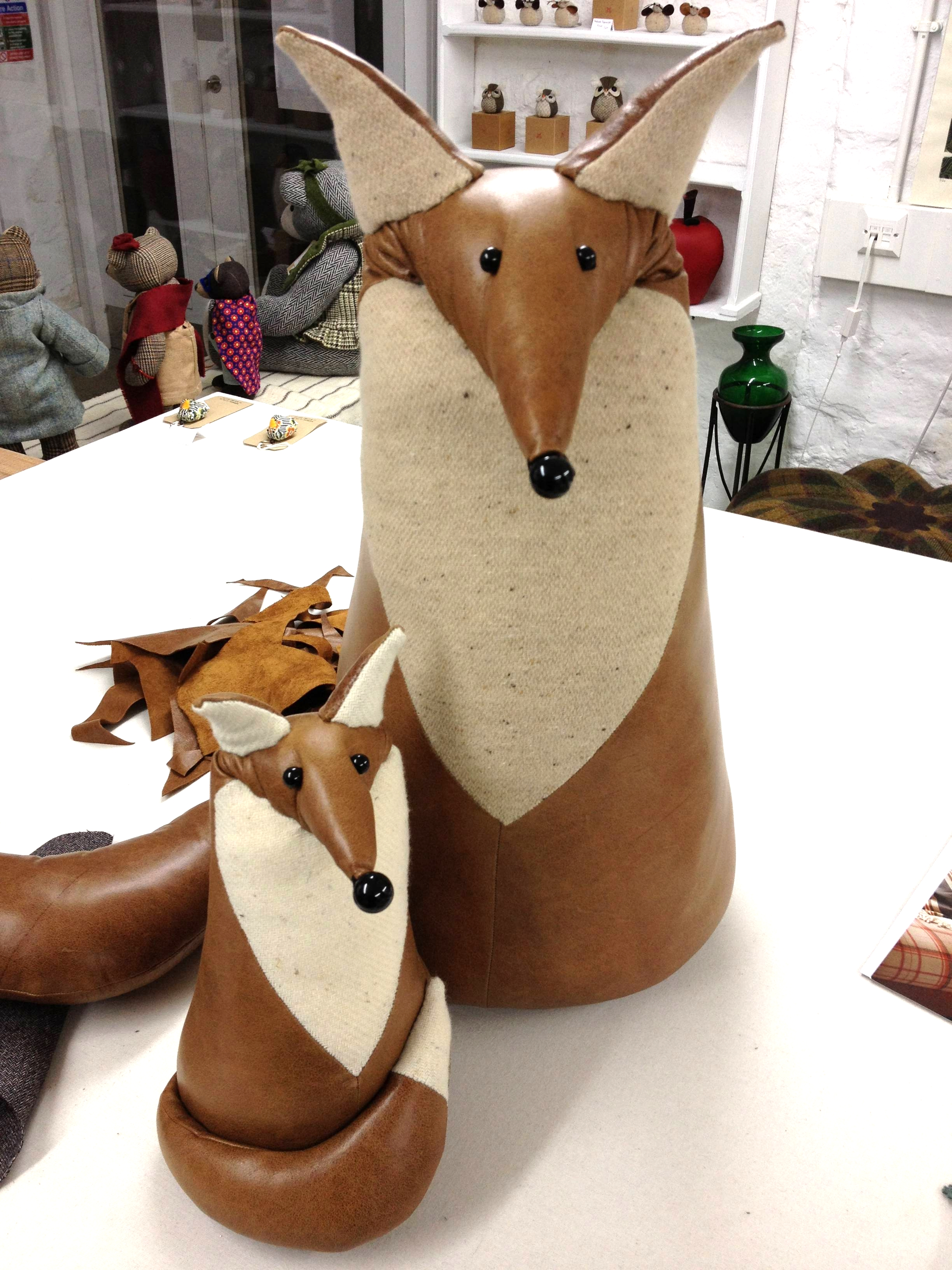 Handmade leather fox sculptures.