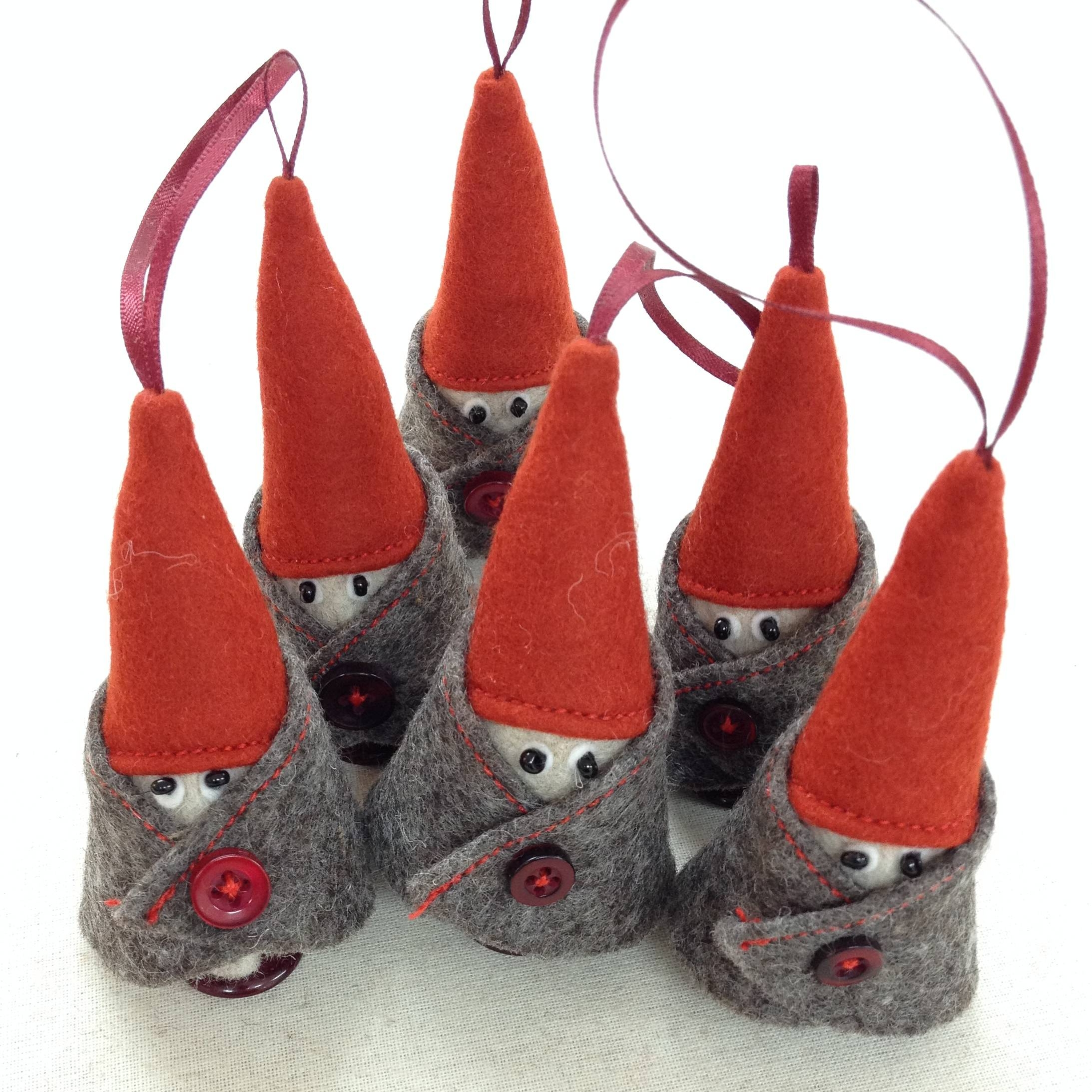 Group of handmade wool felt hanging dwarfs.