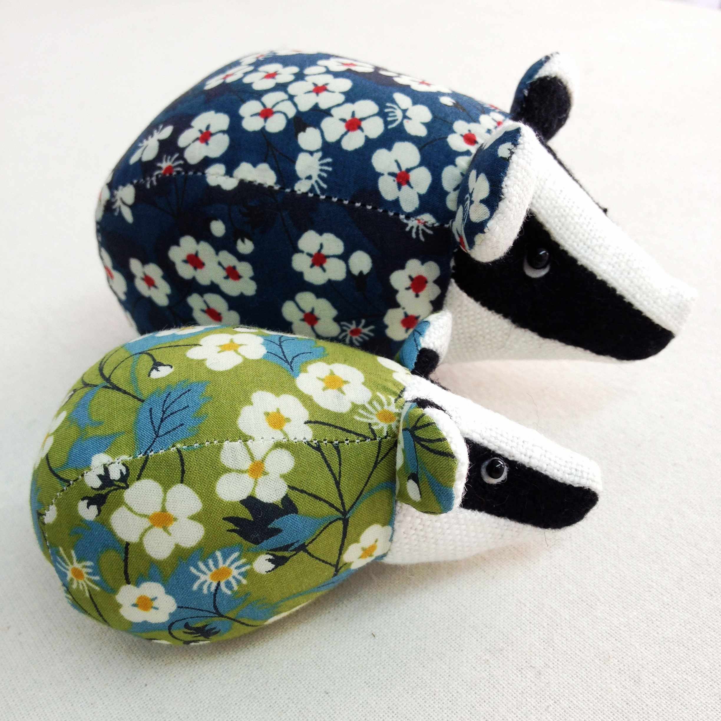 Handmade paperweight badgers in Liberty print fabrics.