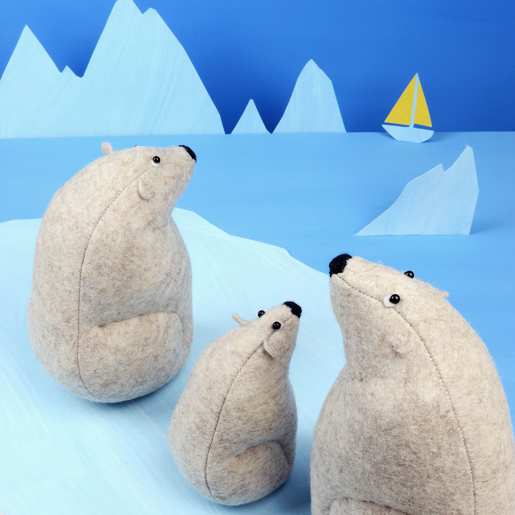 Handmade polar bear felt soft sculptures.
