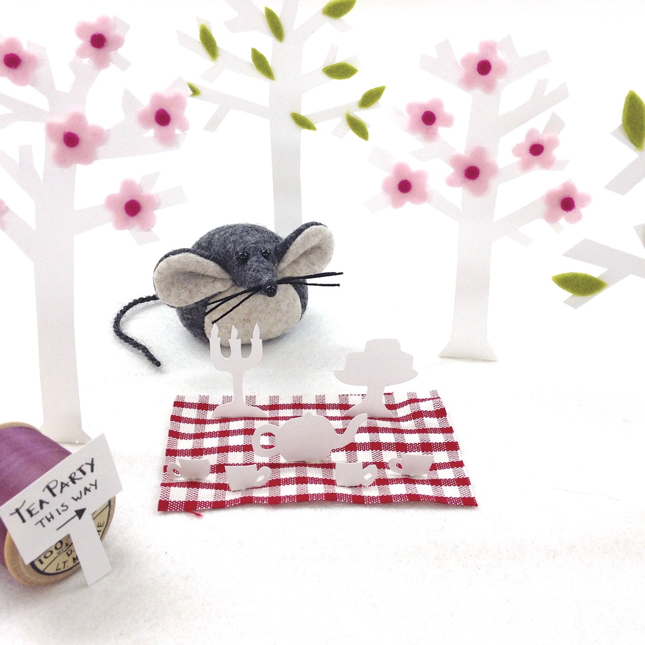 Mika the Mouse from Bilberry Woods Collection getting ready for a tea party in the woods.