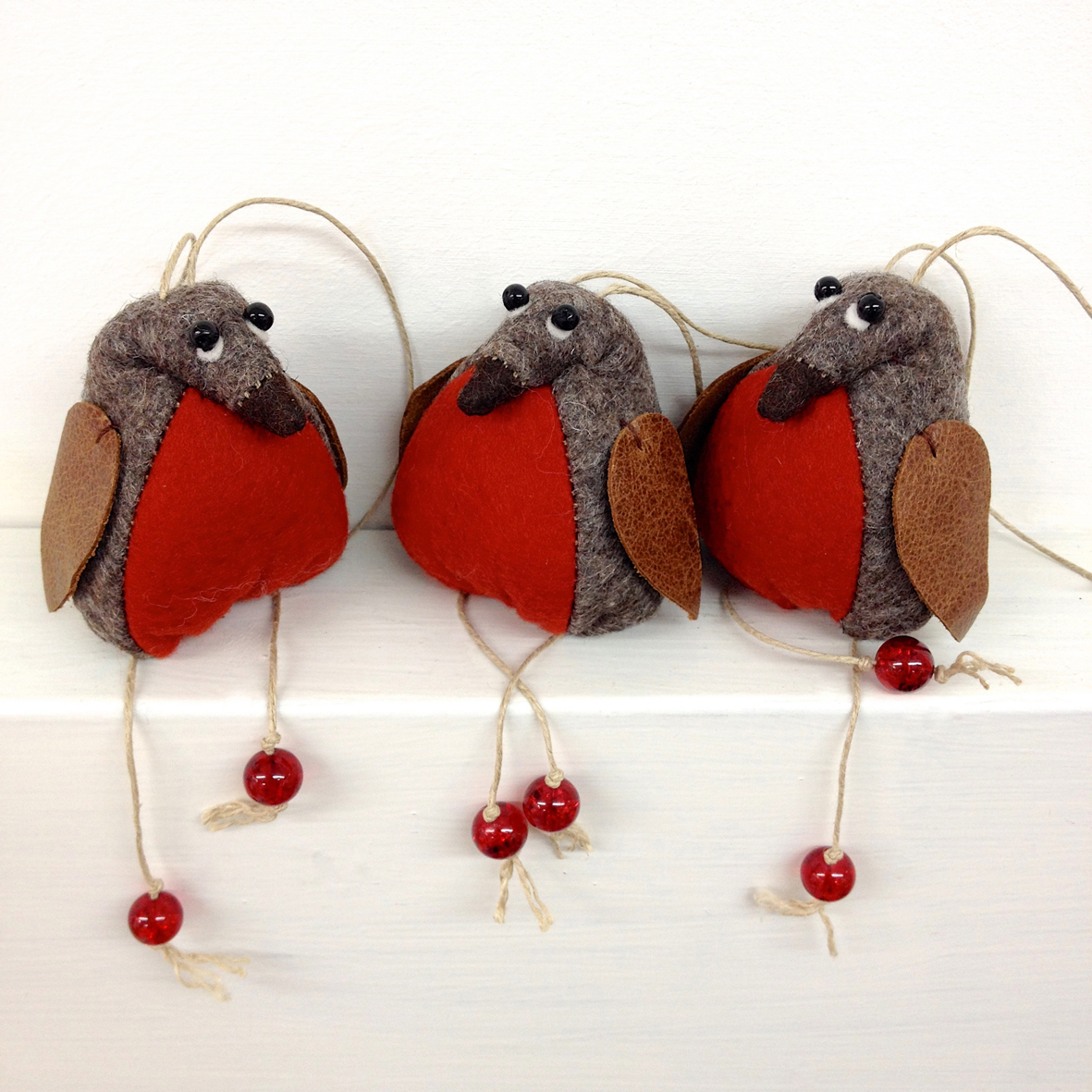 Trio of handmade felt hanging robins.