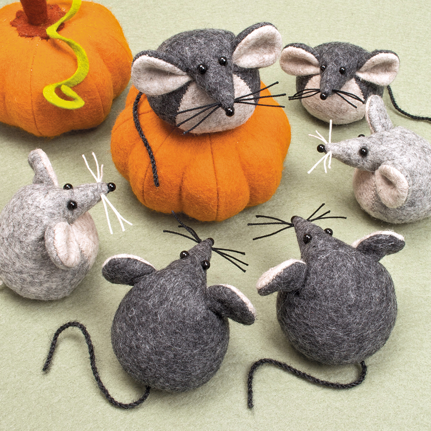 A group of gossiping felt mouse paperweights.
