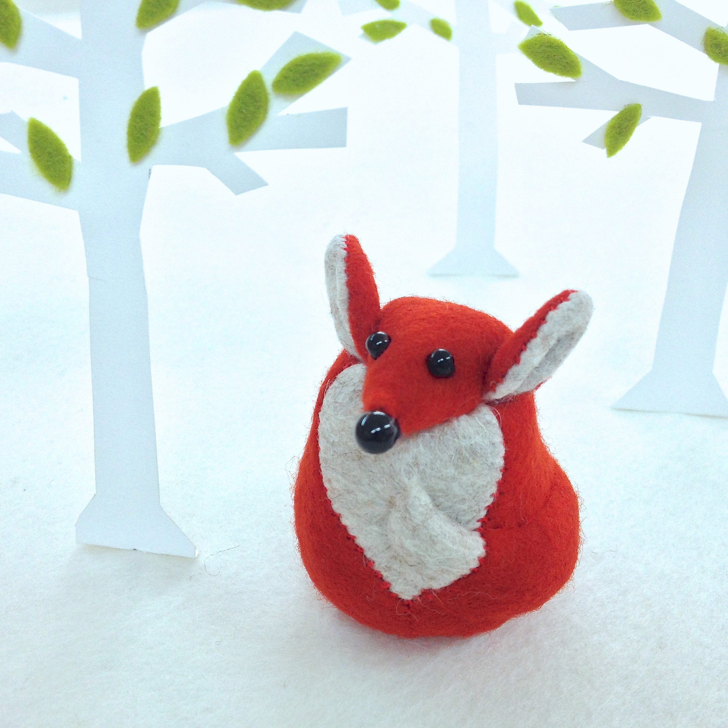 Findlay the Fox paperweight handmade from felt, recycled polyester and weighted with steel.
