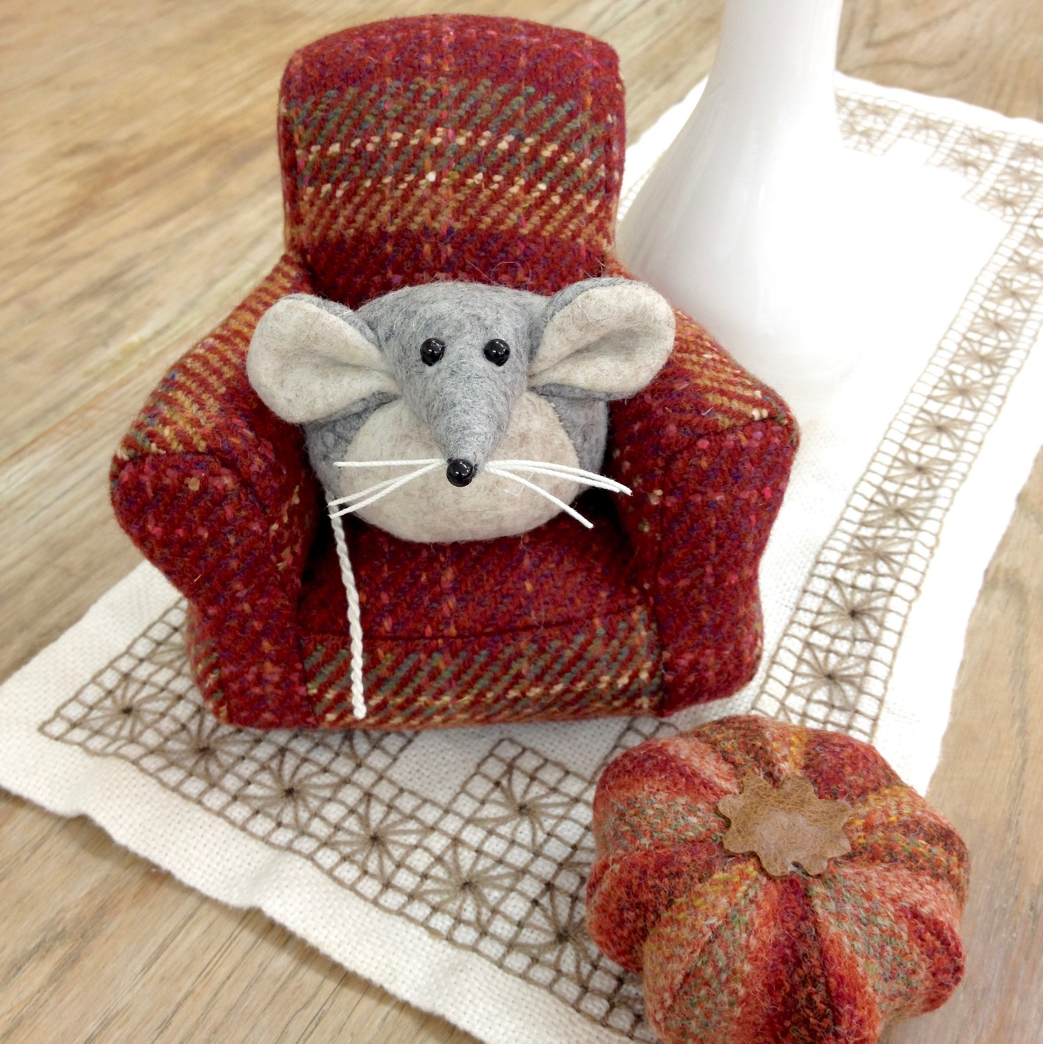 Marie the Mouse relaxing on a red tweed miniature armchair with a matching pumpkin pouffe by Laura Mirjami | Mirjami Design