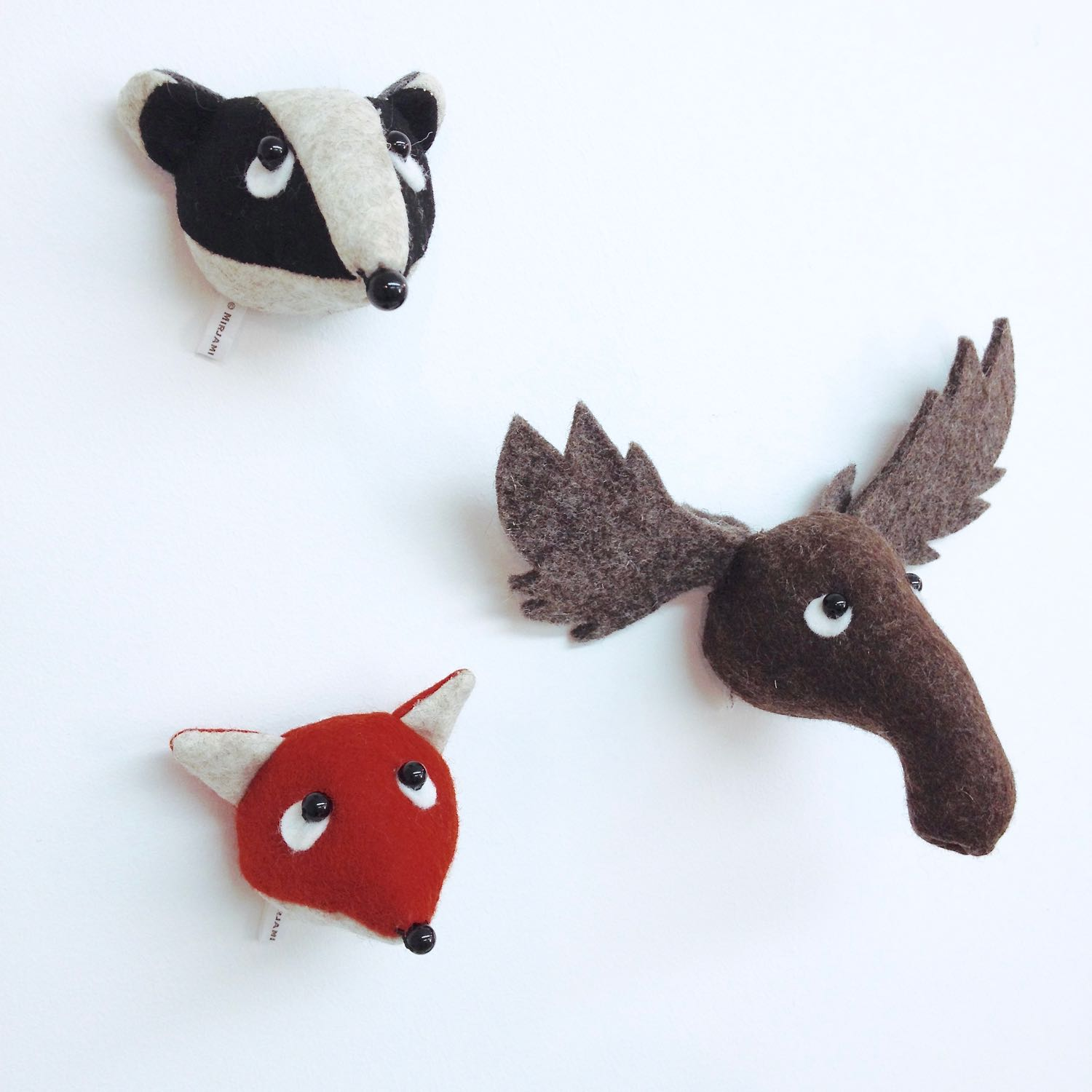 Miniature felt animal wall hangings by Laura Mirjami | Mirjami Design