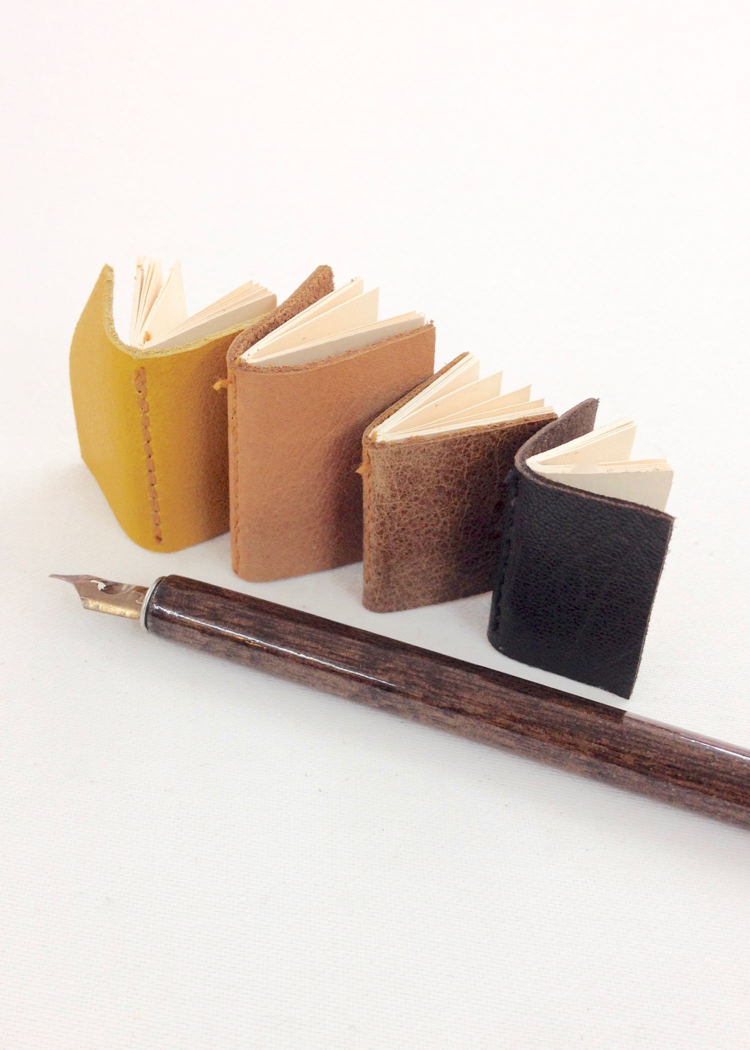 Miniature leather bound books by Laura Mirjami | Mirjami Design