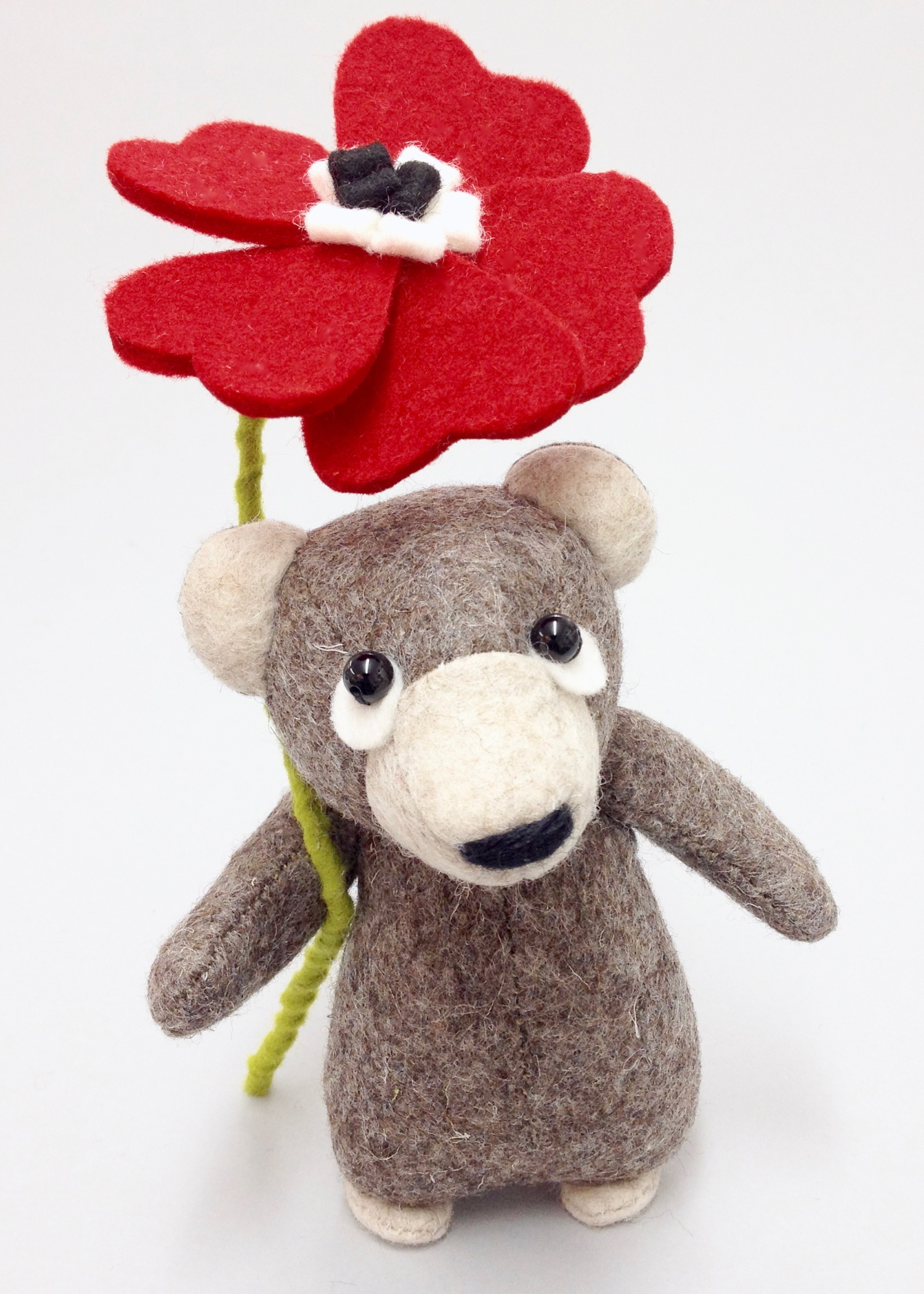 Bilberry Woods brown bear with a felt flower by Laura Mirjami