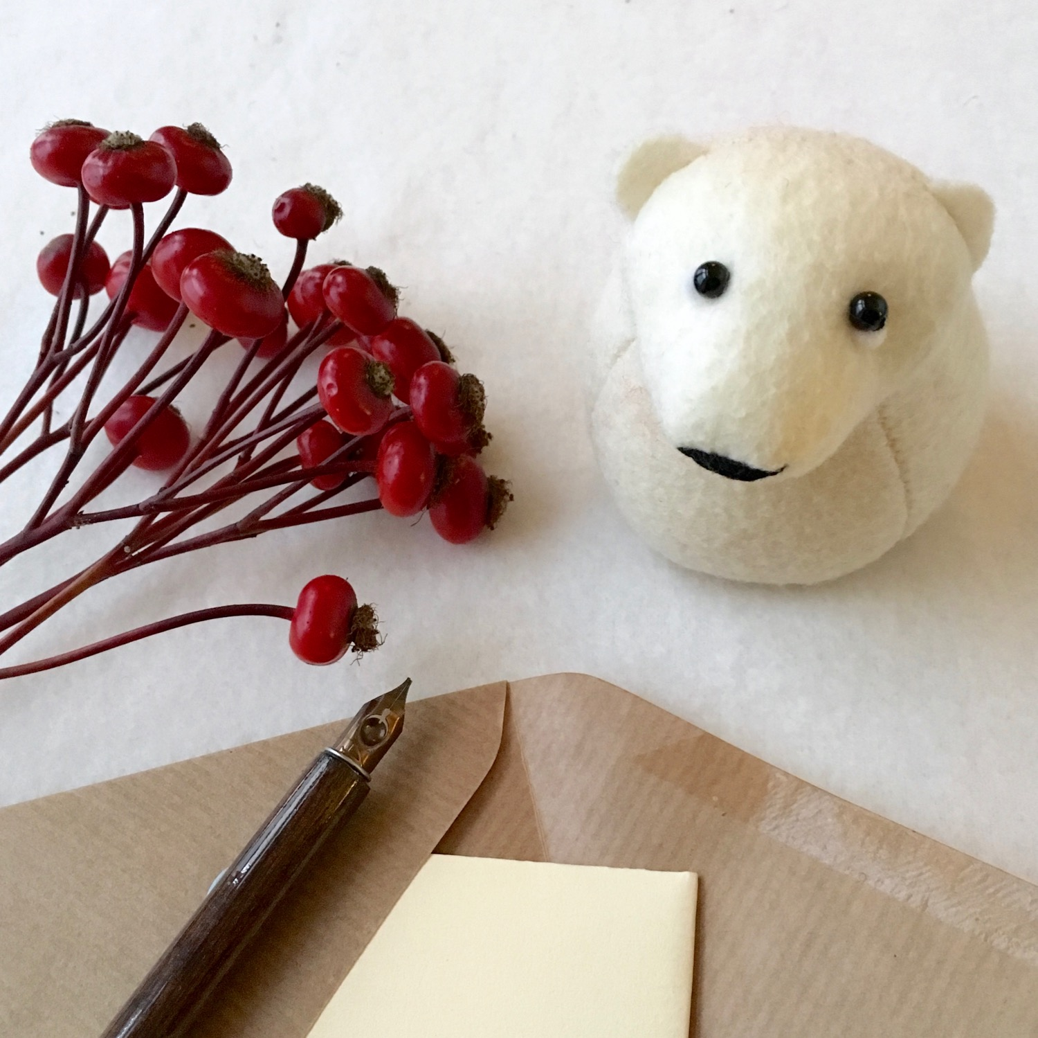 Onni the Polar Bear paperweight | an ideal writing companion | handmade from Kunin eco felt | by Bilberry Woods.jpg