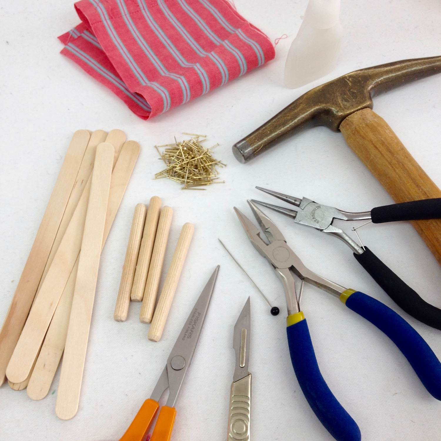 Materials: ice cream sticks (I think I used longer versions from a craft supply), a needle and thread (or a sewing machine), scissors, small nails (used in miniature making), hammer, pliers, wooden dowels (I think I used leftover long IKEA dowels!), some fabric, pencil, sharp blade and a pin (or needle would do too).