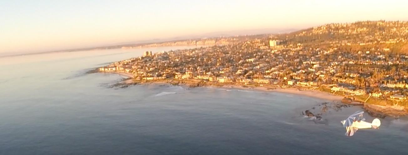 Flying north towards La Jolla Cove along the beach