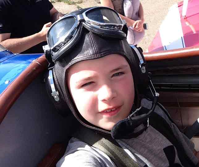 Young Nicky Meli getting set for his first Biplane Flight