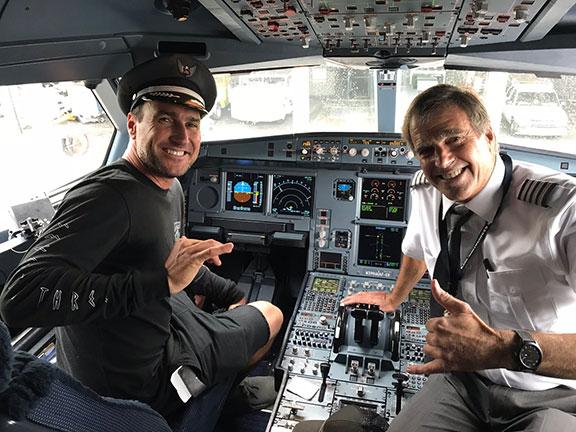 John Wade showing a potential pilot a high tech cockpit.