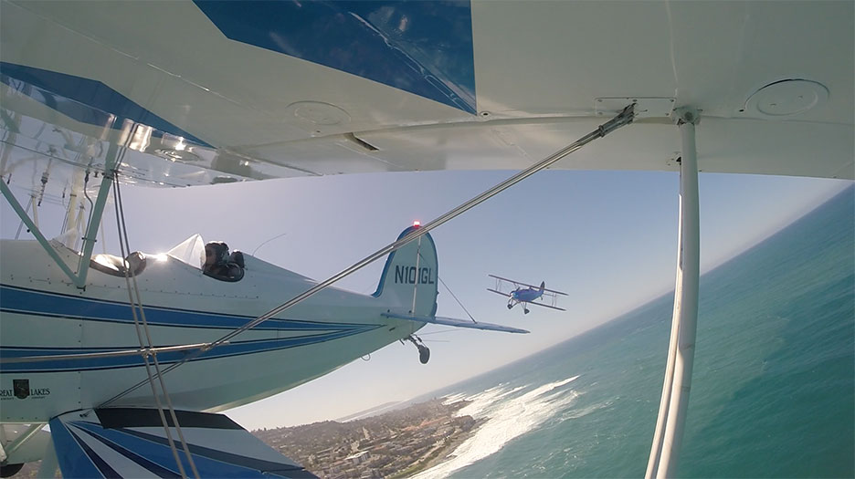 Exciting Biplane Rides around La Jolla Cove in San Diego.  The best airplane ride of your life.