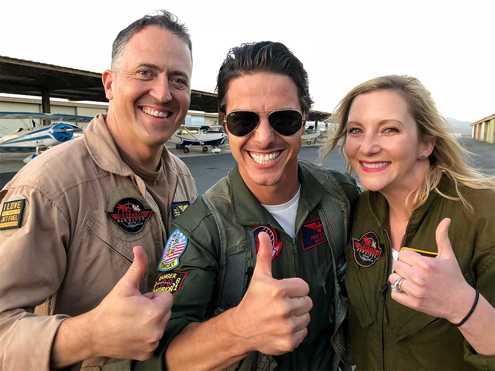 Maverick flies against Navy Pilot 'Arch' in a biplane dogfight. Maverick and Tasha dueled it out in the sky. They loved their biplane rides.