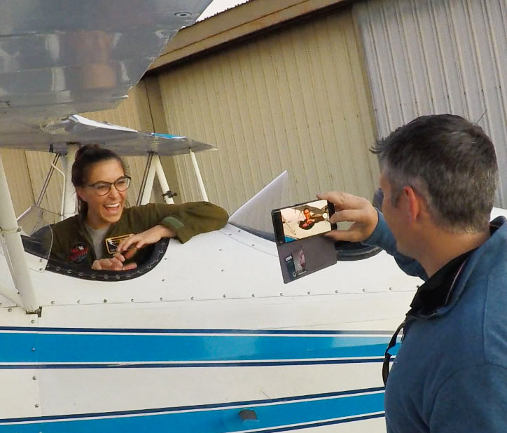 Aubry smiling from ear to ear after her open cockpit biplane adventure.