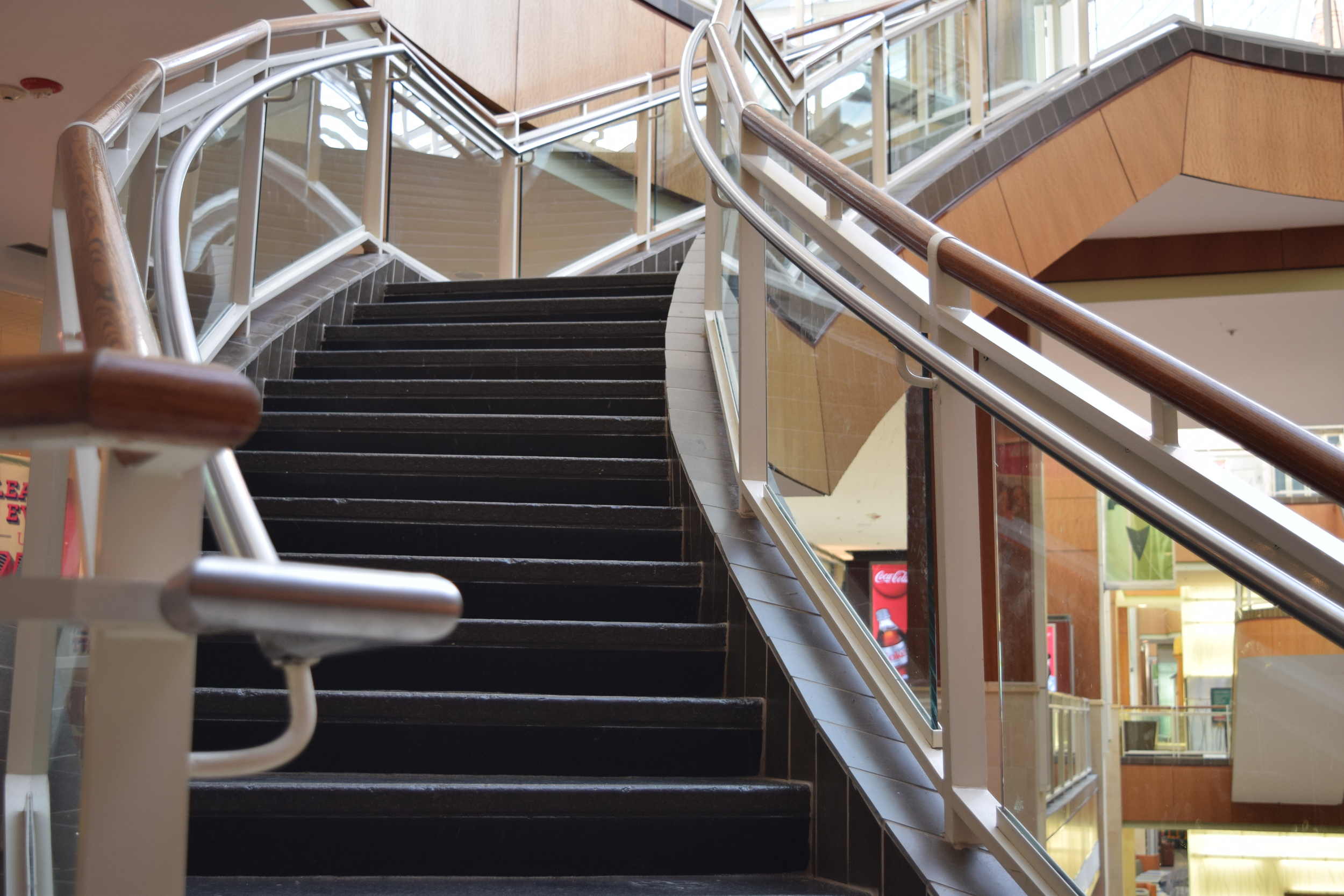 PARK PLAZA MALL  Little Rock, AR  Segmented stainless steel guardrail with wood and glass