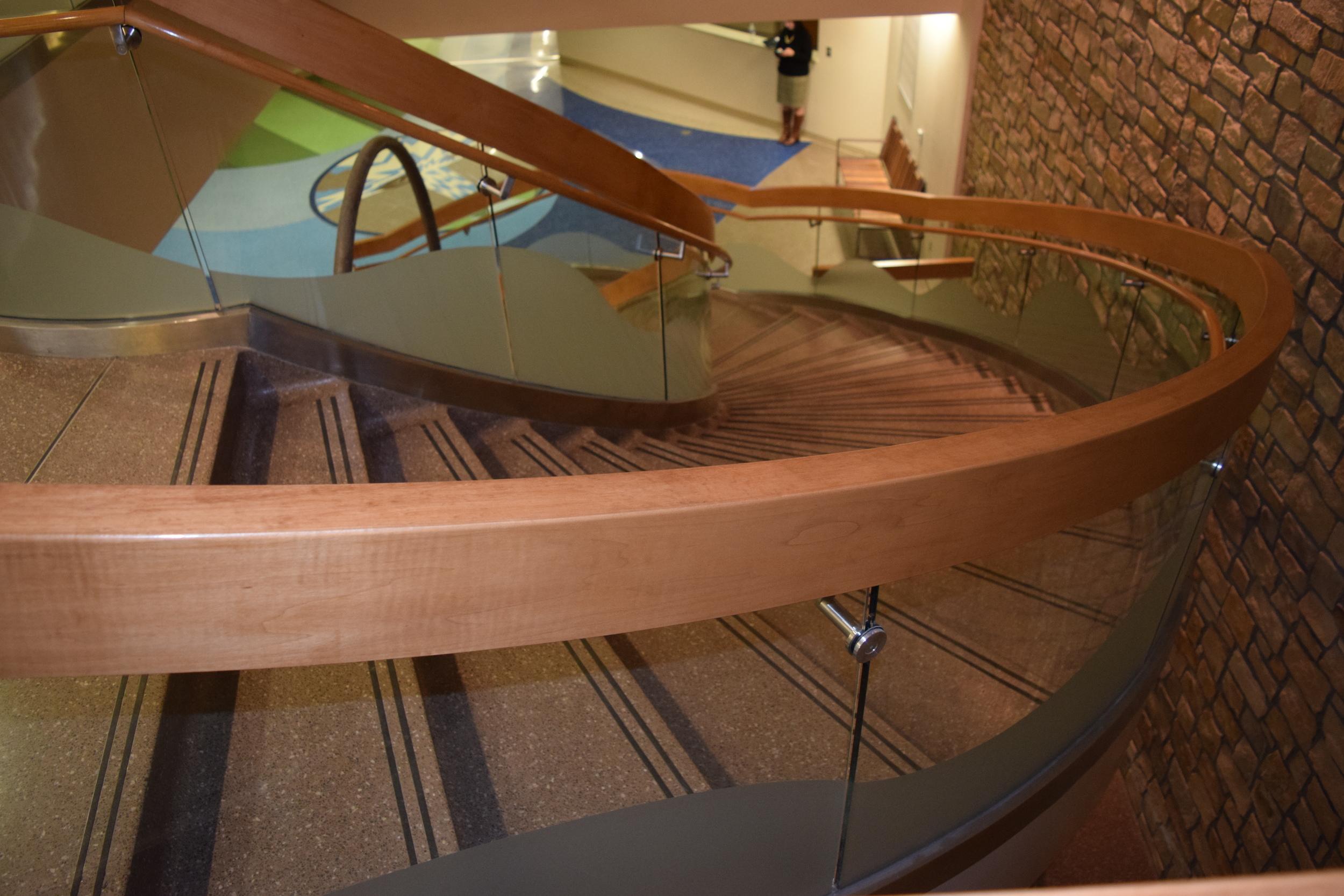 ARKANSAS CHILDREN'S HOSPITAL  Little Rock, AR  Elliptical shaped glass & wood guardrail and handrails