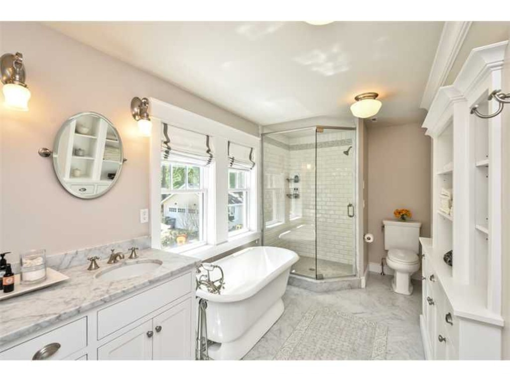 LEED Platinum bathroom marble vanity tub octagonal shower built in cabinets shelves natural light