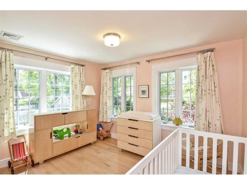 Nursery with natural fiber curtains