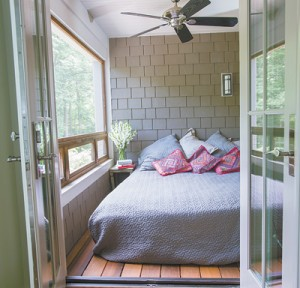 There are plenty of places to sleep, including this cozy screened sleeping porch at the back of the house.