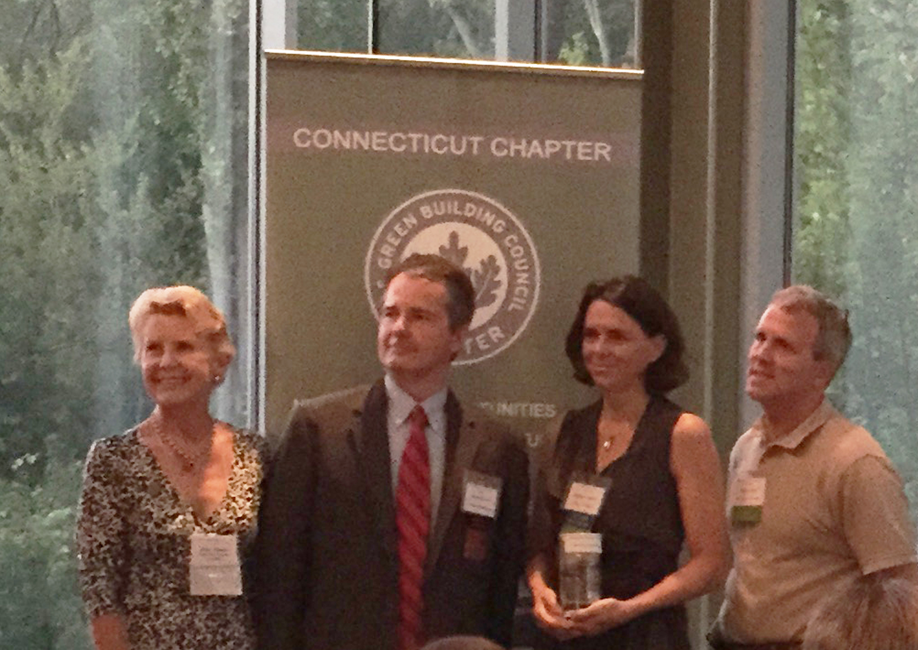 Elizabeth DiSalvo accepting the 2015 CTGBC Green Building Residential award of honor for the Taft School Residence, with Judy Swann~CTGBC, Pat McDonnell~CTGBC, Chris Trolle~BPC Builders.