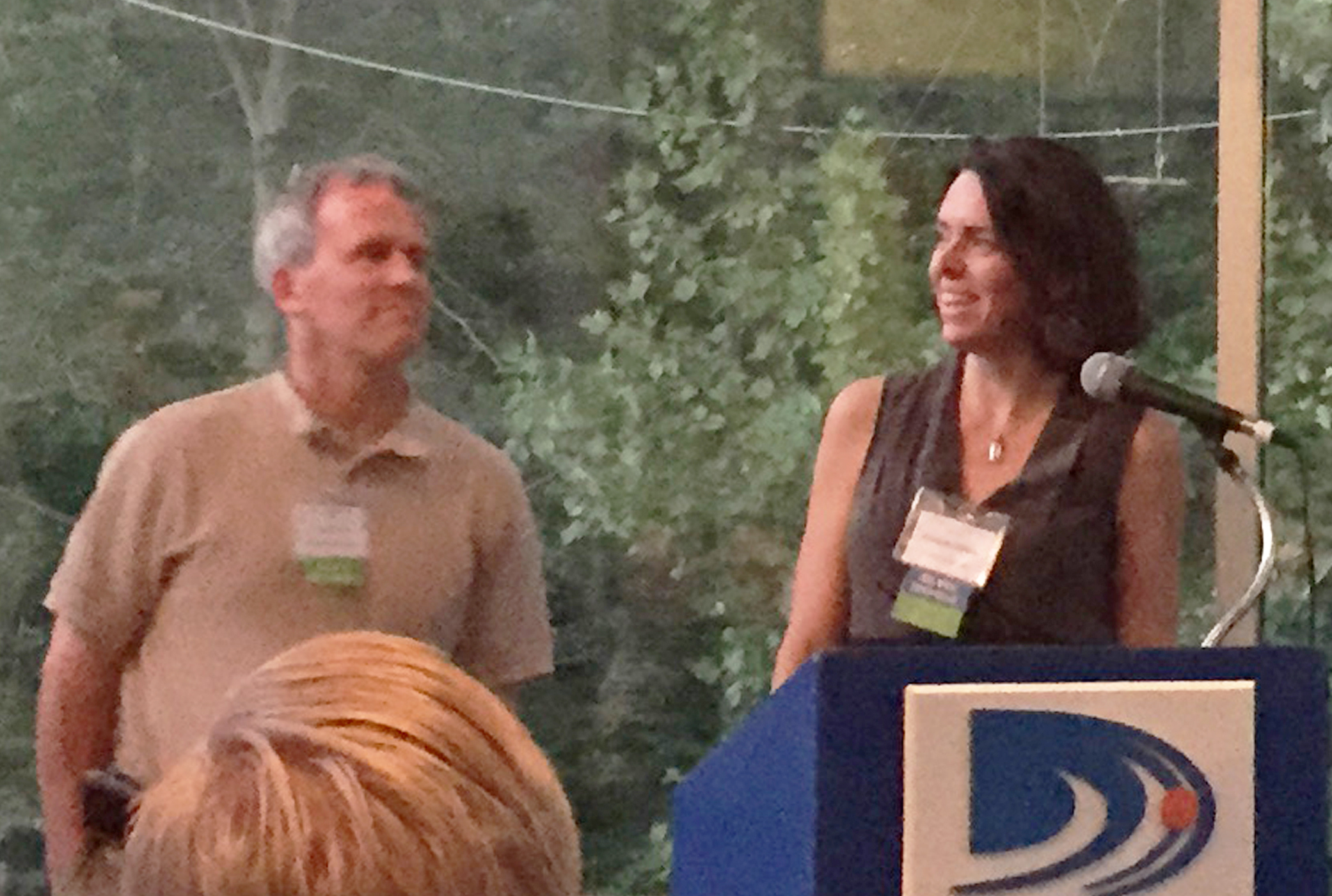 Chris Trolle (BPC Green Builders) + Elizabeth DiSalvo (Trillium Architects) accept the Residential Award of Honor at the CTGBC event.