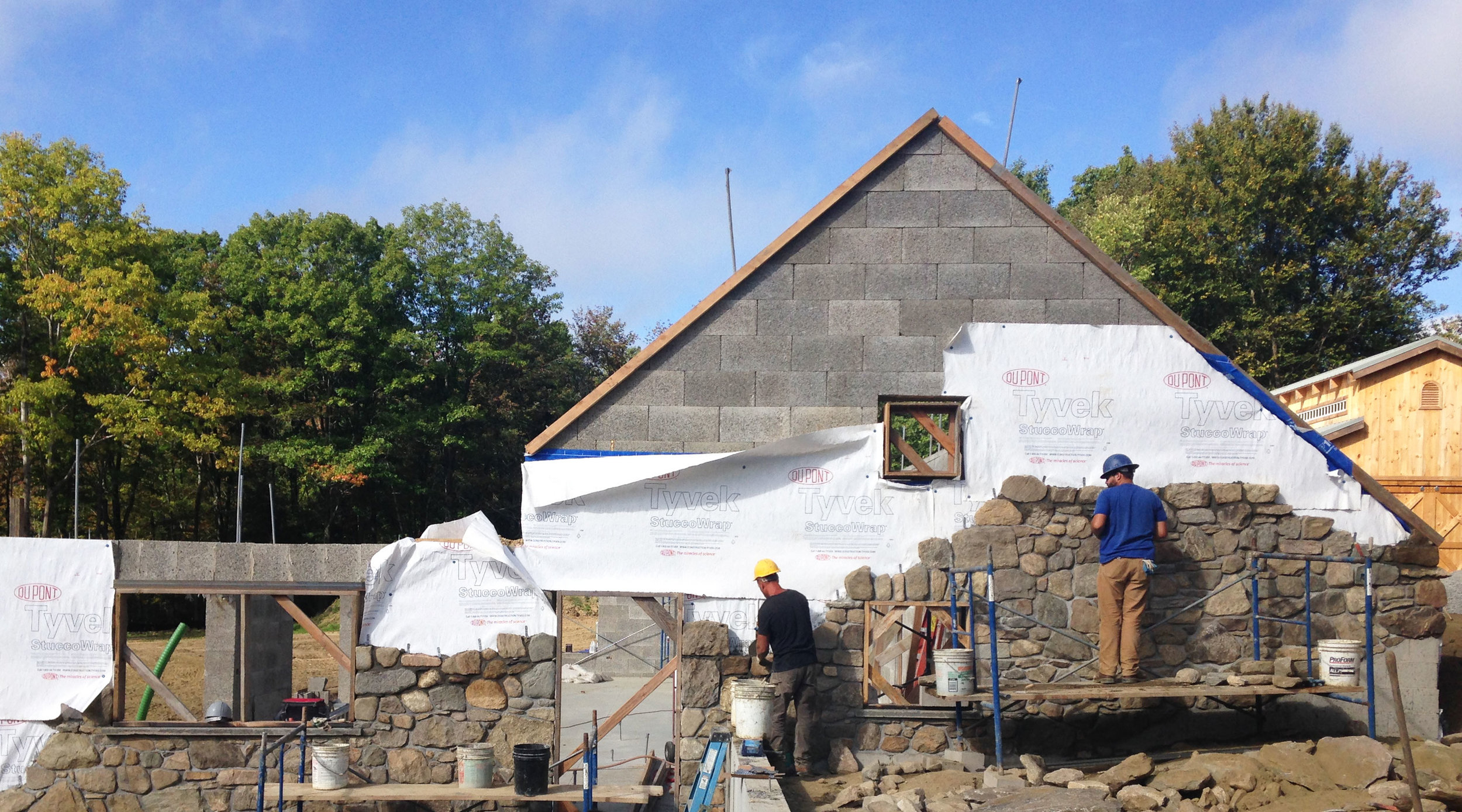 off-the-grid-litchfield-installing-stone-facade.jpg