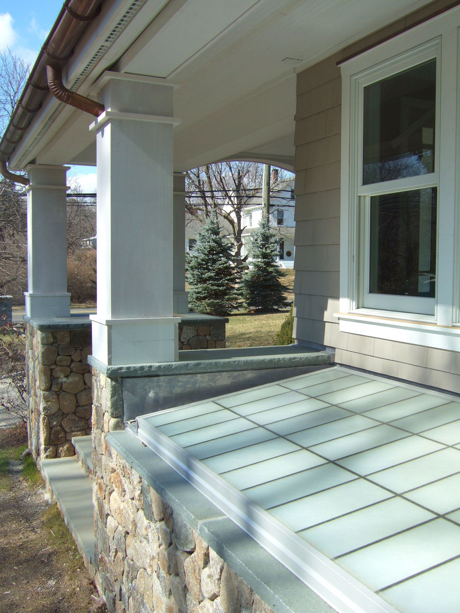 westport-green-renovation-window-well-porch.jpg