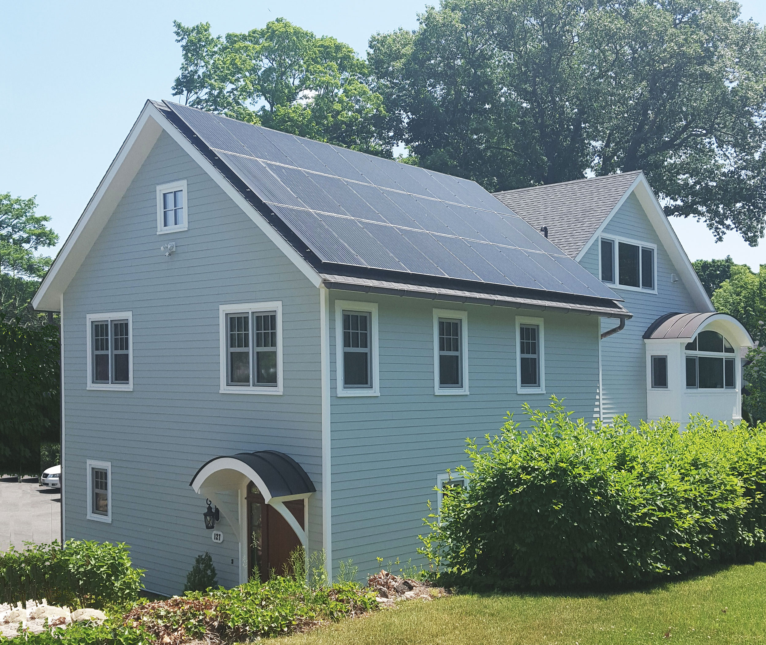 A new home in New Canaan  achieves near net zero energy usage through solar panels combined with a very low electrically supplied heating and cooling load.