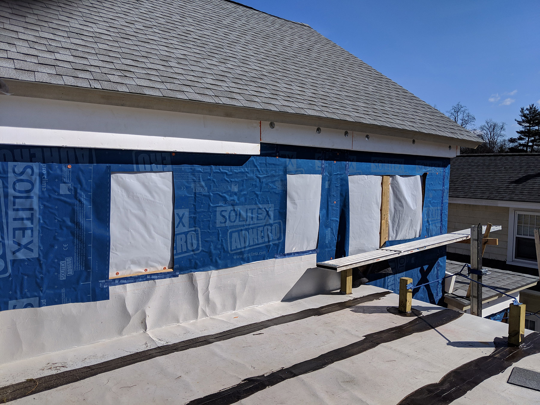 Westchester Passive House 2.26 roof and wrap.jpg
