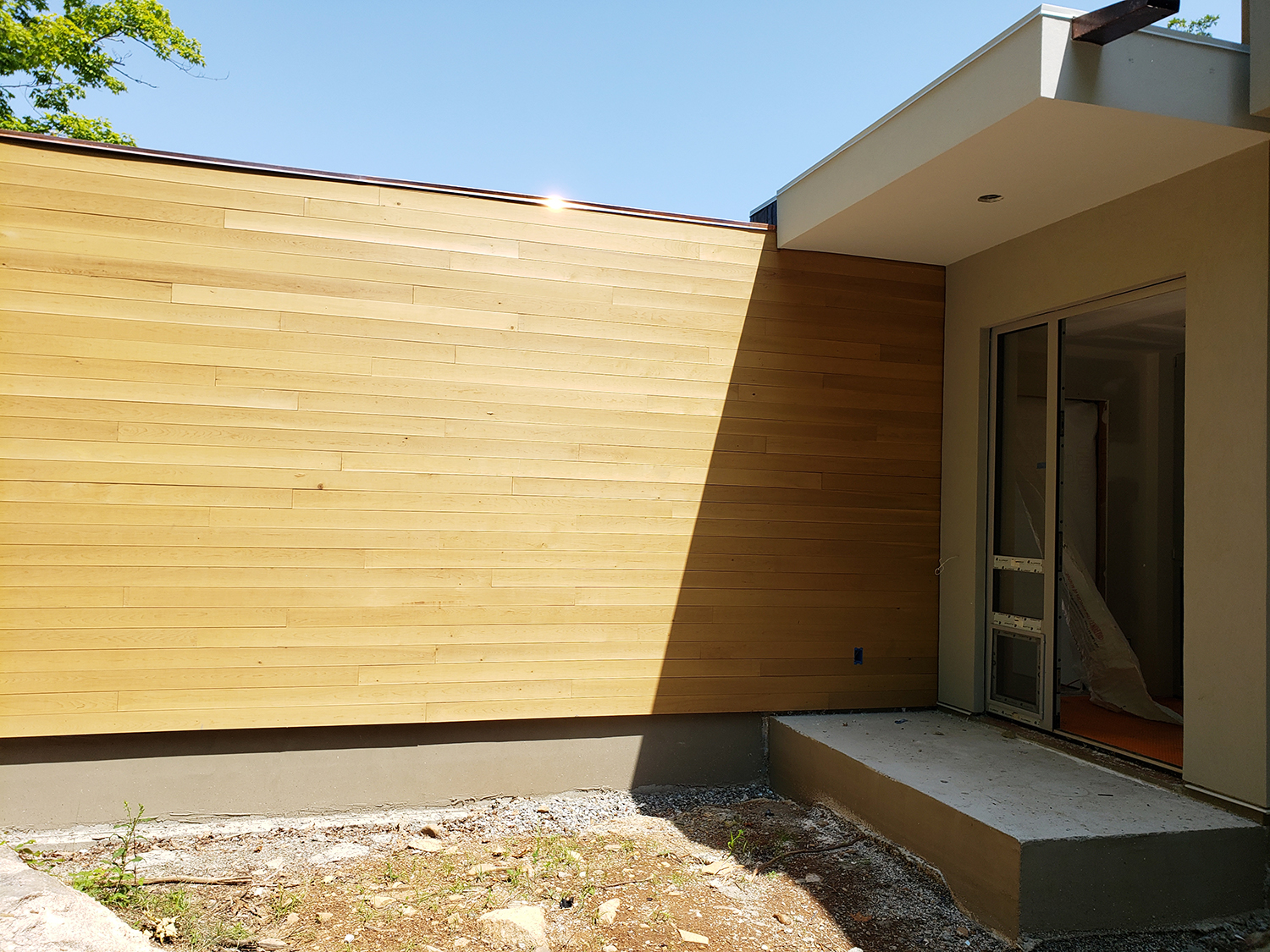 7.26.19 front door and cedar wall.jpg