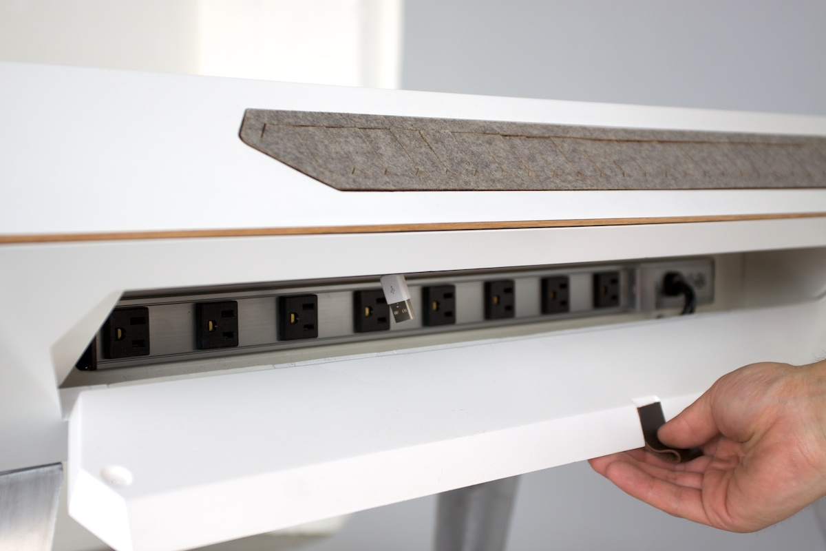 Cable caching compartment with power strip