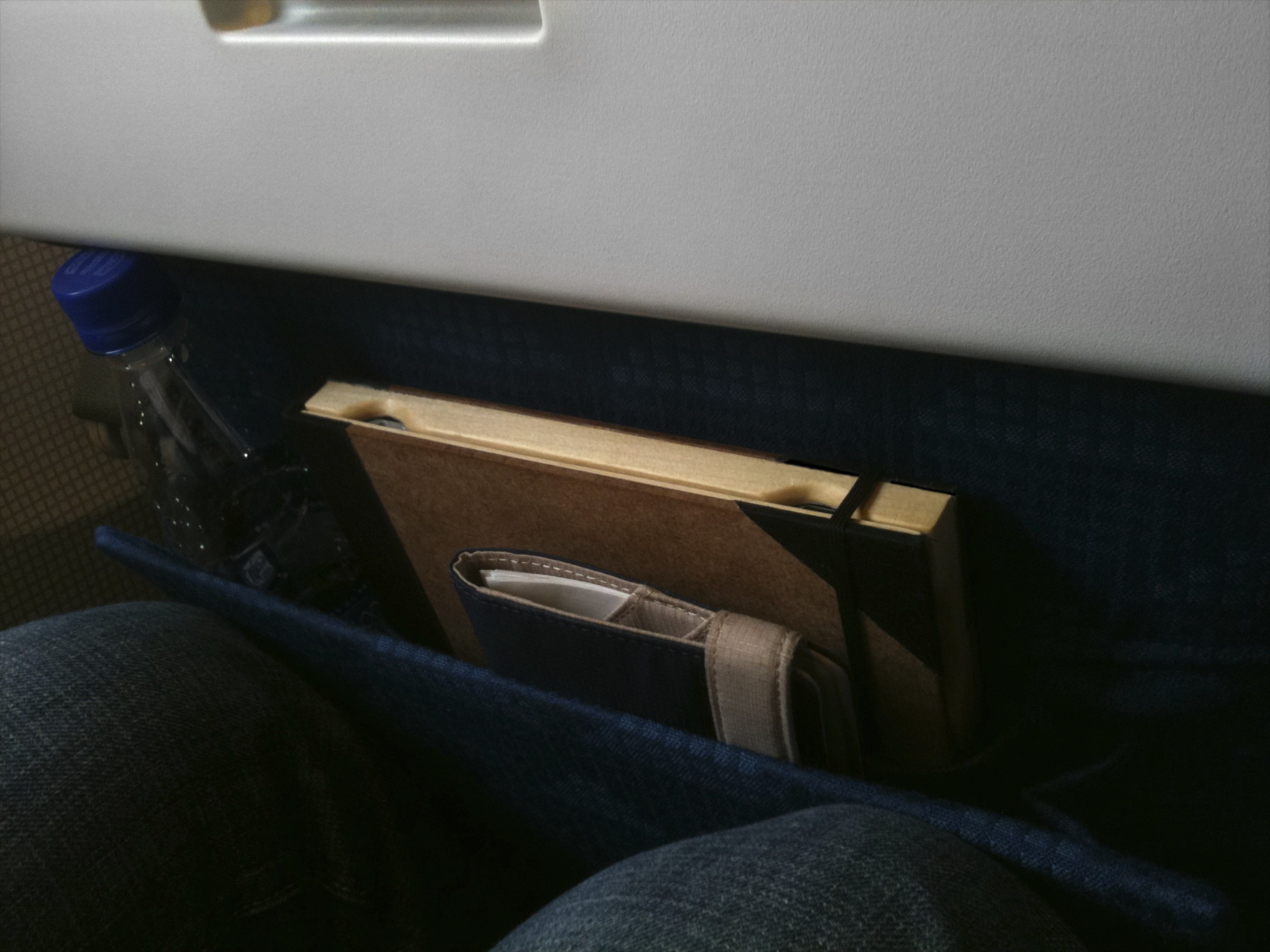 Old Book Case for iPad in a seat pocket of a plane