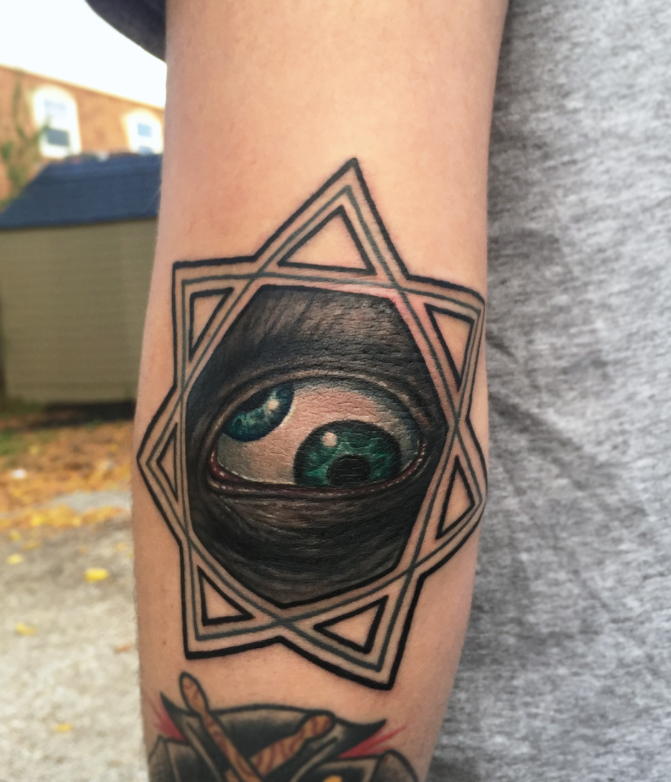 tool_eye_elbow_tattoo.jpg